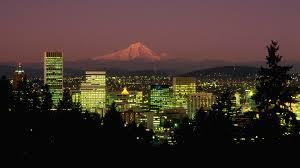 Mt Hood glowing behind a sparkly Portland night